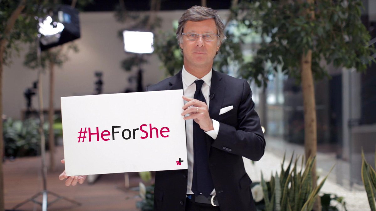 member of Accor holding a HeForShe sign