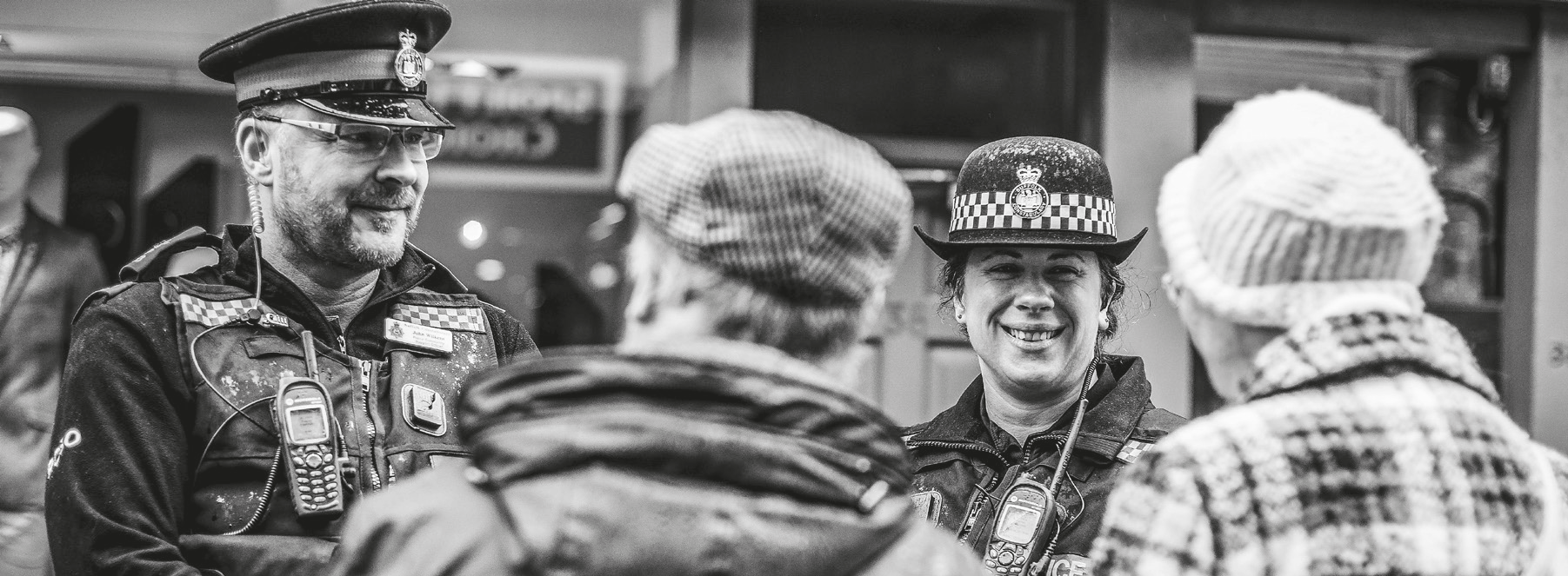 Sussex police officers smiling at an older couple